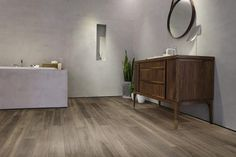 """Our Gladiator 7.5"""" Water Resistant Laminate in Crixus is the ideal water-resistant laminate for bathrooms. Not only is this wood-look laminate water resistant but it is also stain-resistant, and has an embossed register surface for a genuine wood grain texture and visual. It retails starting at $2.99 SQ FT."""