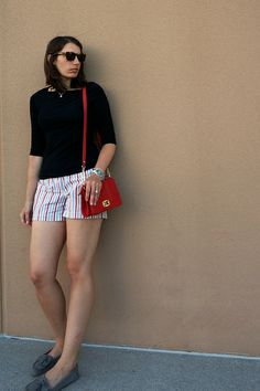How to Wear Golf Shorts When Not On the Golf Course | Style On Target | red purse, black tee, stripe shorts, budget style