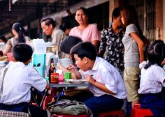 Primary school students eating before class, street 173.