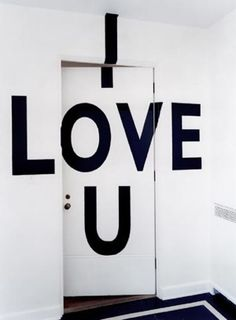 A graphic message, painted directly on the wall, from an interior remodel by Seattle architect and designer Roy McMakin of Domestic Architecture.