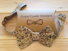 This listing is for a handmade striking Liberty fabric bow tie. Background colour is natural with a lovely design in blue, gold and grey stars. It has a matching strap.  The adjustable strap will fit approximately 16.5 to 21 neck size.  Packaged in recyclable packet  Perfect for every day wear and those special occasions  I ship Worldwide I use Royal Mail 1st class for UK postage Everywhere else, Royal Mail Airmail Proof of postage will be obtained.