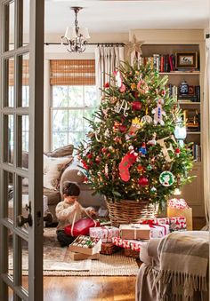 Christmas tree with handmade ornaments. Details: http://www.midwestliving.com/homes/featured-homes/holiday-house-tour-tailor-made-holiday/