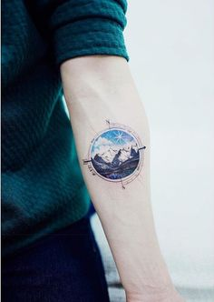Mountain and compass tattoo for sea lovers and sailors