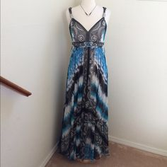 HP 5/6/16Exquisite flowy maxi dress from WHBM Wardrobe Goals HP 5/6/16 This dress is absolutely gorgeous! Wonderful print with blue tones, white and black. Beading at empire waist. Chiffon overlay. Zip back. Excellent pre-owned condition Has one loose bead, not noticeable, but wanted to mention. see photo. Size 6. Non smoking home. White House Black Market Dresses Maxi