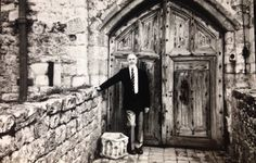 """""""Macabre stories are told of ... a moated manor house of great beauty, character and charm, built in 1340 and outwardly little changed..."""" 'This Haunted Isle' (1986), p.143  (Underwood standing at the original entrance to Ightham Mote in Kent, July 1988)."""