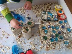 """Animal food & glass nuggets in the sensory tub at 'Garden Gate Child Development Center' ("""",)"""