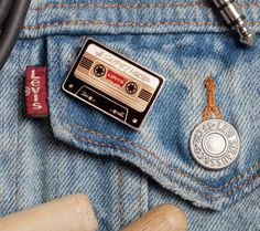 Let's support music together. When you buy a limited edition Levi's Support Music pin, a portion of the proceeds will help provide access to music education programs. Learn more about the cause at levi.com #LiveInLevis