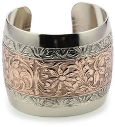 "1928 Jewelry Prominence Silver-Tone and Copper Cuff Bracelet, 7"" 1928 Jewelry,http://www.amazon.com/dp/B002N6WJ30/ref=cm_sw_r_pi_dp_9sPlsb1H796802SG"