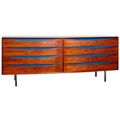 Arne Vodder chest of drawers for Sibast in rosewood  Denmark  1950s  Rare Chest of Drawers by Arne Vodder for Sibast Furniture Denmark.  Original blue drawer inlays and everything else in rosewood.