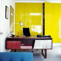 Acid-yellow lacquer makes a statement out of storage in the ground-floor home office, which used to be a garage.
