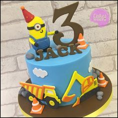 Boys birthday cake with 2d fondant trucks and edible minion