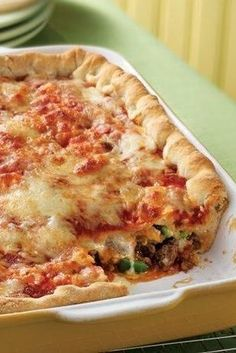 "The ""toppings"" for this pizza are stuffed inside two layers of delicious homemade crust. ""This recipe was awesome! My husband and I both LOVED it! It was really easy to make and pretty quick too!"" says Betty member MrsNewman. Pizza Casserole, Pizza Bake, Pizza Lasagna, Casserole Recipes, Pizza Pizza, Pizza Party, Pizza Dough, Casserole Dishes, Pizza Recipes"