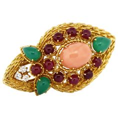 1970s Boucheron Oval Pink Coral Emerald Ruby Gold Cocktail Ring   From a unique collection of vintage cocktail rings at https://www.1stdibs.com/jewelry/rings/cocktail-rings/