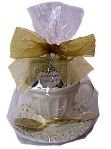 Great favor for a childs tea party, baby shower or bridal shower. Our beautiful BATTENBERG pattern demitasse cup and saucer is beautifully wrapped with gourmet tea and garnished with a lovely gold plated spoon. The cups measure 3 inches high with a saucer diameter of 4.5 inches wide. Elegantly wrapped in cello with coordinating bow for instant gift giving.