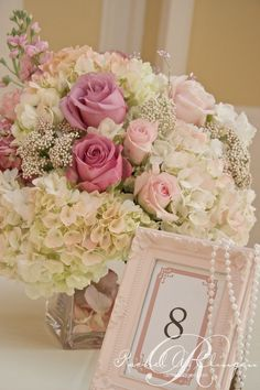 Vintage Wedding. Add pearls over shabby chic wedding reception table numbers.
