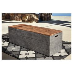 Enjoy hours of rustic warmth seated around the Hatchlands fire pit table. The oversized rectangular design has all the appearances of richly grained wood, but is actually a carefree all-weather composite you'll enjoy gathering around for years. Low profile puts the adjustable propane flame at the right height. Included burner cover transforms the fire table into an expansive coffee table.  Signature Design by Ashley is a registered trademark of Ashley Furniture Industries, Inc.