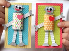 So cute!  A Valentine's robot!  The body is a chocolate bar wrapped in scrap paper!  <3