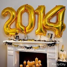 Ring in the New Year with a #CandleImpressions #flameless #candle fireplace & 2014 balloon! Love the use of gold here.