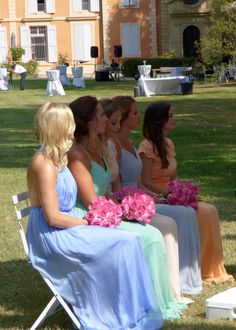 Beautiful bridesmaids in pastels.   Photograph by Cherry Thatcher