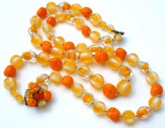 "Orange Art Glass Bead Necklace Vintage 17""  Multi Strand Beaded Jewelry Fashion   This is a beautiful double strand orange art glass & lucite bead necklace.   The beads that are round, uniform in shape are lucite, the rest are glass.  The shortest strand of it necklace is 17"" long, and it has an ornate clasp marked Japan.  in Jewelry & Watches, Vintage & Antique Jewelry, Fine"