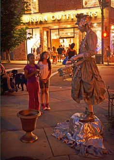 Long-time favorite 'Silver Drummer Girl' - one of the many buskers of an Asheville summer ... photo from The Laurel Of Asheville Magazine : Asheville Lifestyle, Communities, Arts & Culture