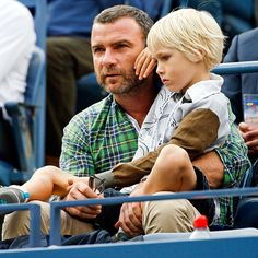 They're 'two' cute! Liev Schreiber and his son Sasha 7 watch the men's singles final match between Japan's Kei Nishikori and Croatia's Marin Cilic (who won) from the Mercedes-Benz suite at the U. Open in New York on Monday night. Kei Nishikori, Little Boy Haircuts, Liev Schreiber, Monday Night, Celebrity Babies, Croatia, Little Boys, Movie Stars, The Man