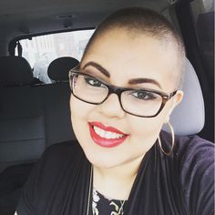 Shaved Head - Bald - Breast Cancer Fighter - Hair Growth after Chemo - Woman's Short hair cut with bright red bold lip and hoop earrings. thick plastic glasses complete this look!