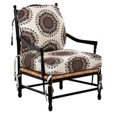 LIZA ARM CHAIR Featuring medallion-printed cotton upholstery and a turned wood frame, this eye-catching arm chair brings exotic appeal to your living room or home library.