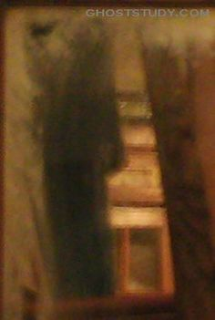 """Did Al Capone know this ghost? Chris writes, """"This pic was taken at Ricco d's in Willow Springs, ILL. in October 2006. When I took the pic there was nothing there. I was later told at a paranormal conference by a ''medium'' that this was a woman who was held against her will at this location and killed. Ricco d's used to be owned by Al Capone."""""""