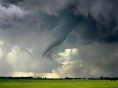 A tornado funnel begins to form over farmlands in southern Alberta.