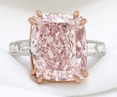 $7.8 Million, 12-Carat Pink Diamond On Display In Person And Online - The cushion-cut diamond is mounted on an 18k rose gold and platinum ring. The asking price is $7.85 million.