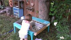 Outside play kitchen from recycled objects. - this would be so cute with an old sink.   now to find a sink.