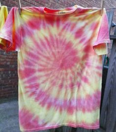 Spring break 99! Spiral tie die colored light orange and yellow. Party like it's 1999 all the time with this shirt