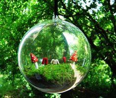 Hanging Terrarium.  Something I got try.  http://indiebliss.com/terrarium-centerpieces