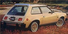 Yellow AMC Spirit Hatchback -  this was my first car...always mistaken for a Gremlin.