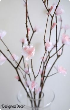 Tissue Paper Flowers - DeDe from Designed Décor offers cherry blossoms created from tissue paper and then hot glued onto branches. It is amazing how real they look!