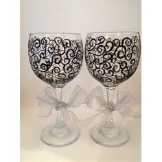 Wine glasses hand painted. You could do any design, Mr & Mrs or Bride & Groom. Great for the wedding toast