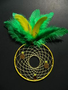 """Pineapple Dream Catcher 5"""" yellow ring accented with green & yellow feathers and pineapple embellishments."""