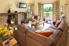 The Cowbyre sitting room complete with log burner for a cosy evening