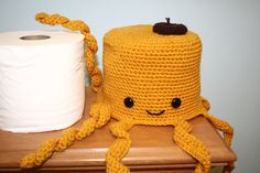 crocheted octopus toilet paper cover - what a clever way to conceal your extra roll!