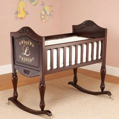 Monogrammed Grace Cradle - With detailed carvings embellishing our Monogrammed Grace Cradle, this elegant cradle is the perfect one for your sleeping beauty. Crafted of rich, sturdy wood, your little one will be safely ensconced as he/she sleeps like a dream.