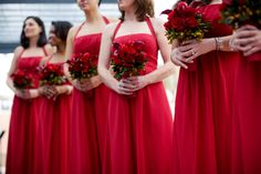 Red bridesmaids dresses with rose wedding bouquet, photo by Melissa Jill Photography