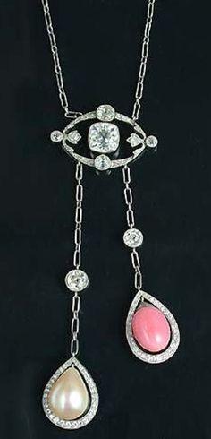 A belle époque diamond, pearl and conch pearl négligée pendant, circa 1910