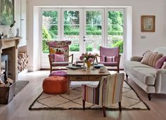 Traditional living room with mismatched chairs...furniture layout (couch and chairs)