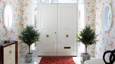 I like this entry....... Those double doors and oval windows.  It feels like spring and summer!