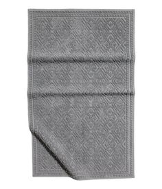 Charcoal gray. Rectangular bath mat in thick, jacquard-weave cotton terry. Non-slip protection at back.