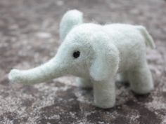 This is a cute handmade needle felted Mint Elephant - your new friend.  Made from pure wool using needle felting techniques.    Dimensions:  H - 10cm,
