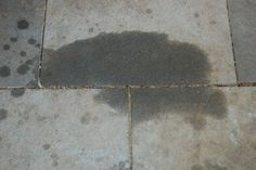 How to remove oil/grease from cement or pavers