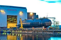 Artful, the third highly-complex Astute class submarine designed and built by BAE Systems for the Royal Navy, appears outside her constructi...