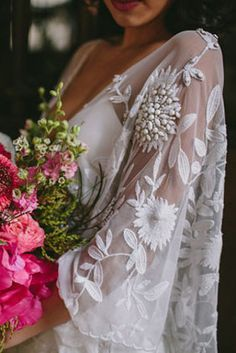 These vintage-inspired bell sleeves: | 32 Strikingly Beautiful Wedding Dress Details